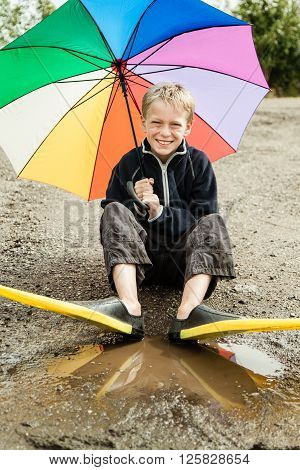 Single Child In Diving Flippers And Umbrella