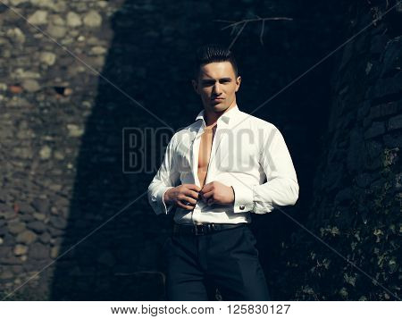 Young Model Man Undoes Buttons