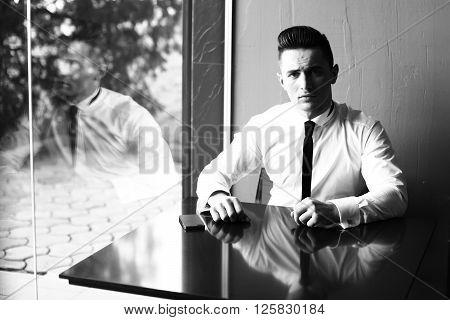 Man Reflects In Window