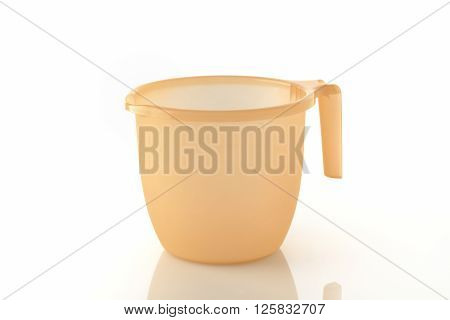 Bathroom Mug / High resolution image of orange plastic bathroom mugs.