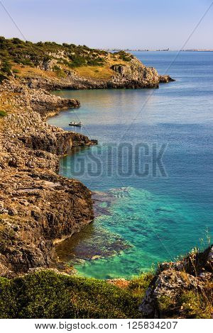 SUMMER SEASCAPE. Salento coast:Bay Uluzzo (Lecce).ITALY (Apulia).Bay Uluzzo .In the background the city of Gallipoli. Bay Uluzzo is a small natural gulf located within the protected area known as Porto Selvaggio.