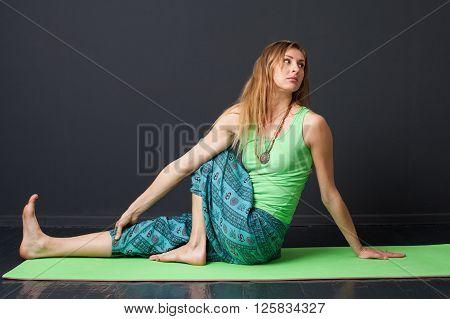 Woman Performing Yoga Asana