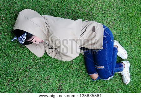 Cute Girl Sleep on grass in the Garden