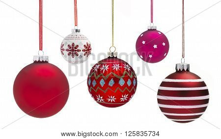 Christmas Baubles hanging with a white background