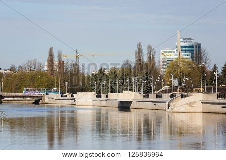 Kaliningrad Russia - April 15 2016: View of the new embankment Tributsa with reflection in river spring time