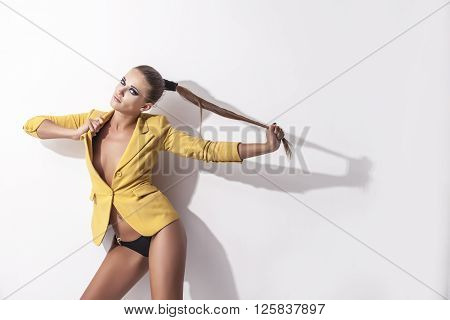 Model Woman In Bikini And Yellow Stylish Jacket And  Makeup On White Background