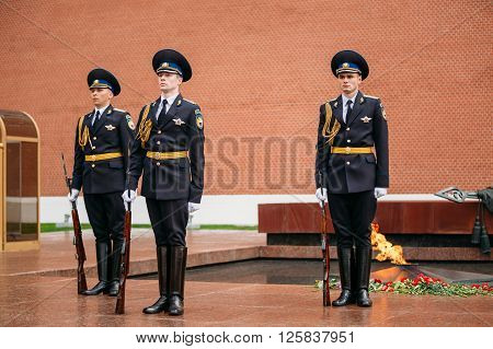 Moscow, Russia - May 24, 2015: Post honor guard at the Eternal Flame in Moscow at the Tomb of the Unknown Soldier - Post number 1 in the Alexander Garden in Moscow close by Kremlin walls