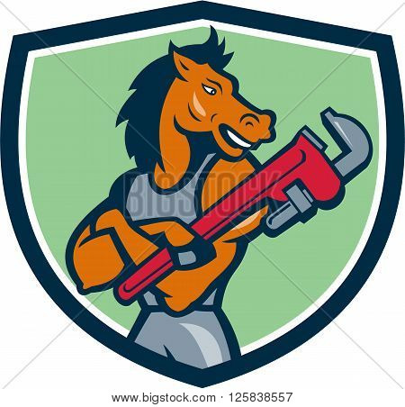 Illustration of a horse plumber arms crossed holding monkey wrench looking to the side set inside shield crest on isolated background done in cartoon style.