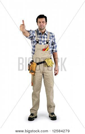 Portrait of a worker in overalls with thumb raised on white background