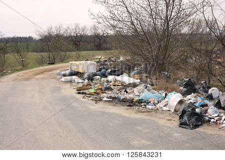 Ugly Garbage dump next to a road