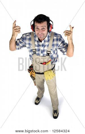 Portrait of a worker in overalls with noise-canceling headphones on white background