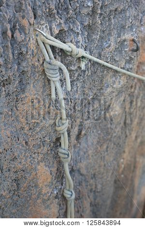 closeup of carbine and rope in stone