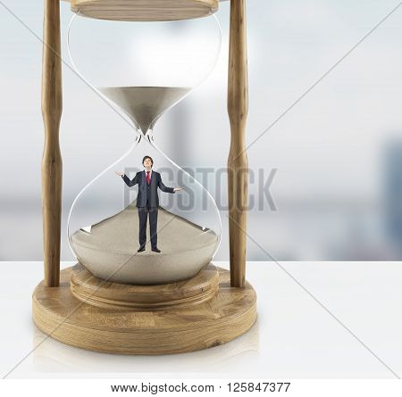 Uncertain businessman inside hourglass. 3D Rendering. Close up