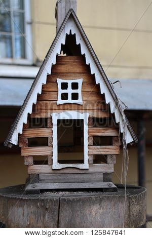 the feeder Small house birdhouse close to