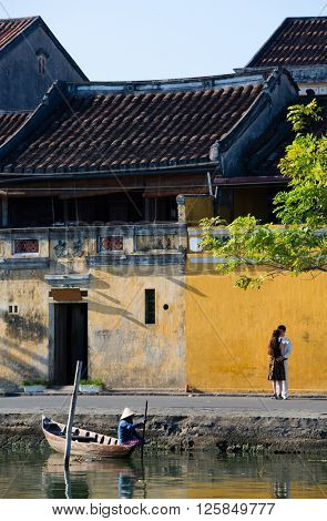 HOI AN, VIETNAM - SEPTEMBER 5, 2015: unidentified young Vietnamese couple are posing for a wedding picture in Hoi An,Vietnam