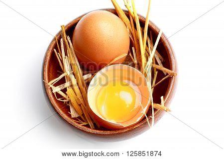 two fresh broken egg in the hay