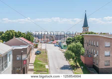 PORT ELIZABETH SOUTH AFRICA - FEBRUARY 27 2016: A view of Kirkwood Street in North End in Port Elizabeth with the Nelson Mandela Bay Stadium in the back