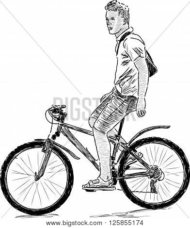 Vector drawing of a boy rides on a bicycle.