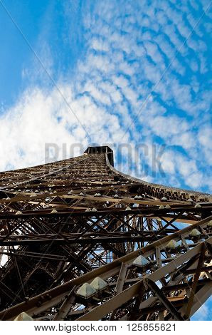 Eiffel Tower from below with beautiful blue sky in the background.