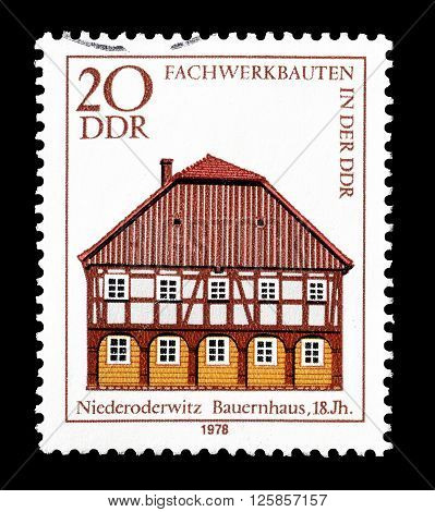 GERMAN DEMOCRATIC REPUBLIC - CIRCA 1978 : Cancelled postage stamp printed by German Democratic Republic, that shows Farmhouse Niederoderwitz.