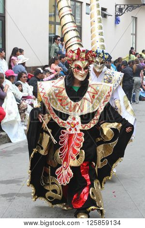 Cajamarca Peru - February 7 2016: Two costumed figures with tall hats marching in the Carnival Parade in Cajamarca Peru on February 7 2016.