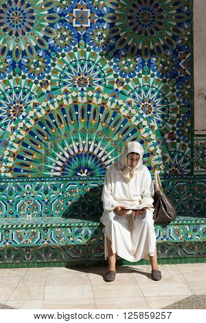 One Muslim Woman Reads Book In Grand Mosque Of Hassan Ii
