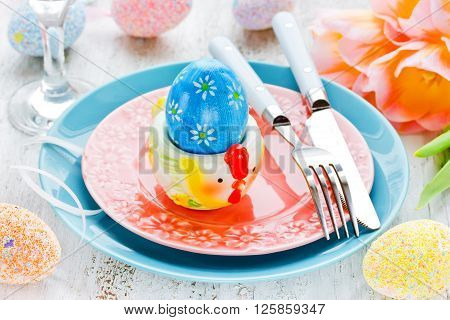 Easter table setting with holiday decor colorful eggs tulip plate cutlery beautiful Easter food concept selective focus