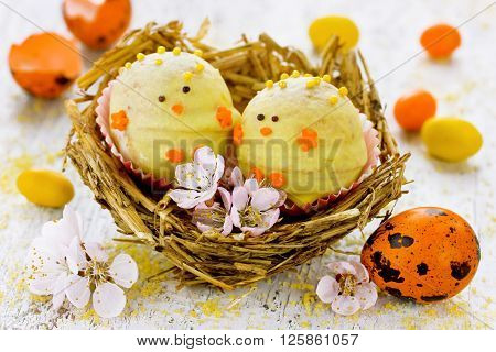 Easter candy chick in nest festive sweet treat for children selective focus