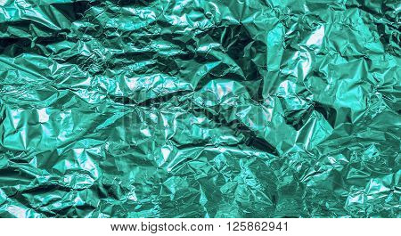 Turquoise Crumpled Aluminum Foil Texture Background High Contrasted