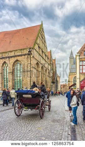 A Horse-drawn Carriage On Mariastraat, Bruges, Belgium