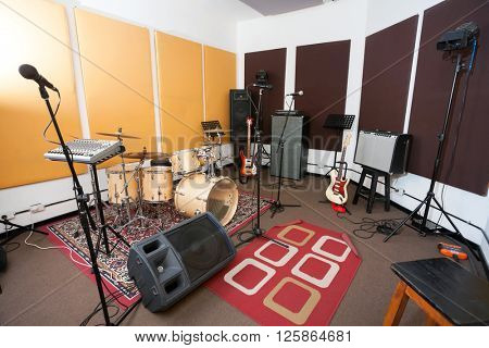 Microphones And Musical Instrument In Studio