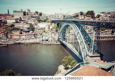 View of the historic city of Porto Portugal with the Dom Luiz bridge.
