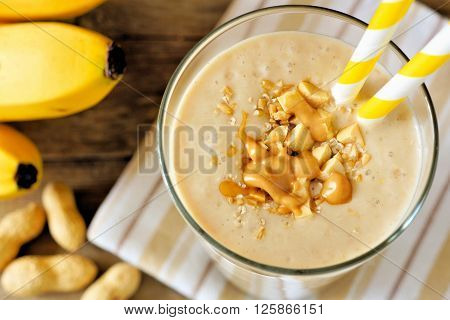 Peanut Butter Banana Oat Smoothie With Paper Straws Close Up, Downward View With Cloth