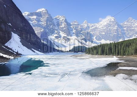Moraine lake under the ice. Banff National park. Canada.
