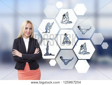 Young businesswoman with hands crossed hexagonals with yoga postures next to her. Concept of sport.
