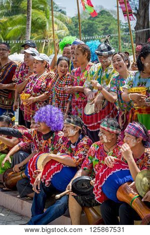 PHUKET THAILAND - APRIL 13 2016: Unidentified traditionally dressed people at the street side preparing to Songkran Festival celebrated in a traditional New Year's Day. ** Note: Soft Focus at 100%, best at smaller sizes