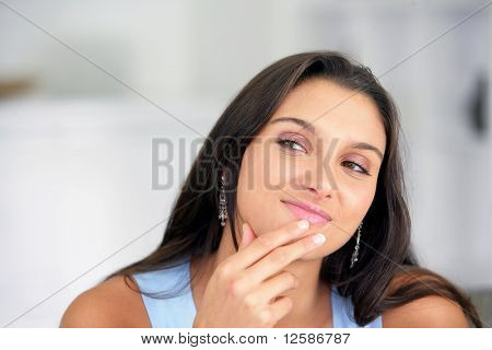 Portrait of a young woman pensive