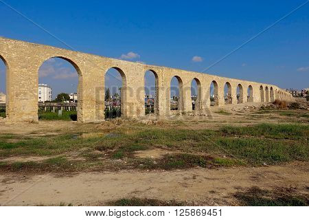 Larnaca, Cyprus, December 18, 2015: The Kamares Aqueduct build in 1747 by Bekir Pasha to supply Larnaca with water.