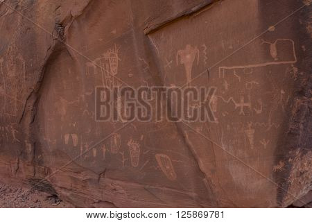 Carved pictograph petroglyph created on sandstone in the desert southwest