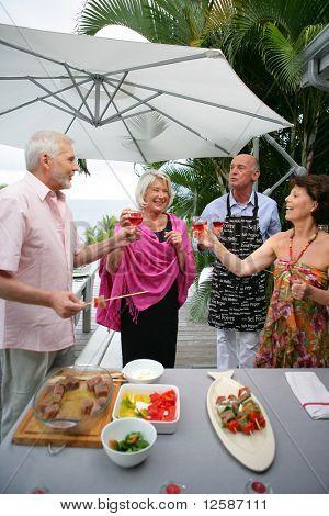 Senior group having a toast on a terrace