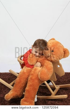 baby girl with teddy bear