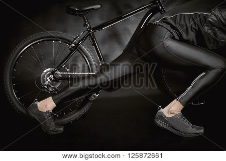 Athlete With A Bicycle Isolated On Black