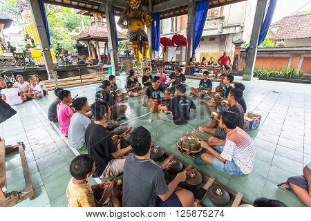 UBUD, INDONESIA - MAR 1, 2016: Unidentified teenagers at the time of preparations for Ngrupuk parade, which takes place on the eve of Nyepi day in Bali. Nyepi is a public holiday in Indonesia.