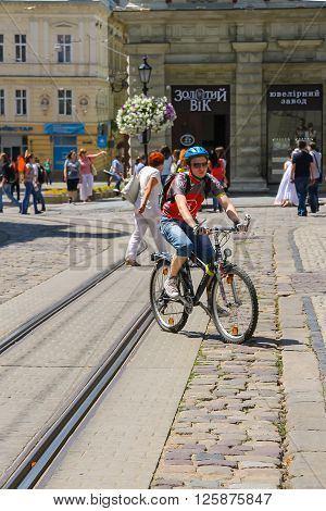 Lviv Ukraine - July 5 2014: People on street in the Old Town (Rynok Square). Lviv historic city center is on the UNESCO World Heritage List