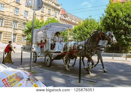 Lviv Ukraine - July 5 2014: Tourist brougham with people on the streets in historical city center