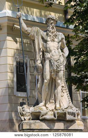 Neptune fountain in historic city centre. Lviv Ukraine