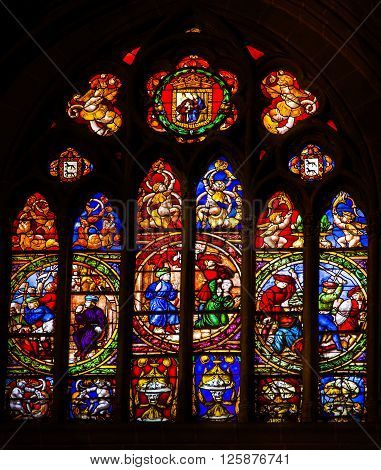 TOLEDO, SPAIN -  MAY 16, 2014 Medieval Life War Stained Glass Cathedral Spanish Flag Toledo Spain. Cathedral started in 1226 finished 1493