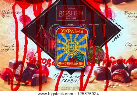 ILLUSTRATIVE EDITORIAL.Chevron of Ukrainian army. With logo Roshen Inc. Trademark Roshen is property of Ukrainian president Poroshenko.At April 15,2016 in Kiev, Ukraine
