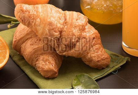 fresh croissants on a green linen cloth