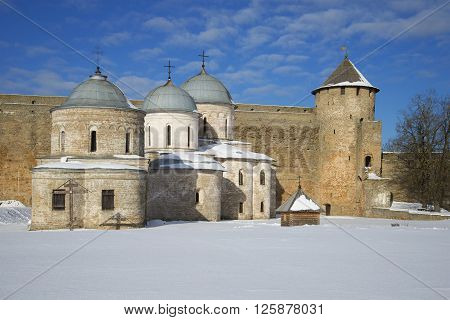 Assumption and St. Nicholas Church at the gate towers, winter day. Ivangorod, Leningrad region, Russia